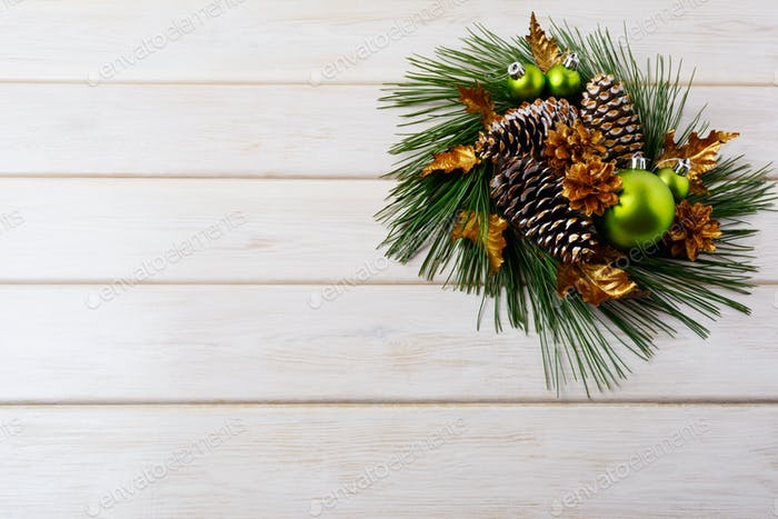 Christmas background with holiday golden cones decorated wreath