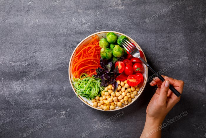 Raw mixed Vegetables and chickpeas.Vegetarian Buddha Bowl.