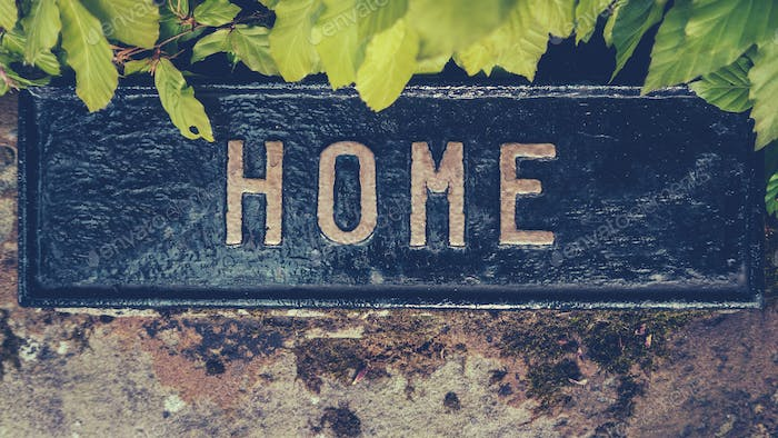 Overgrown Home Sign