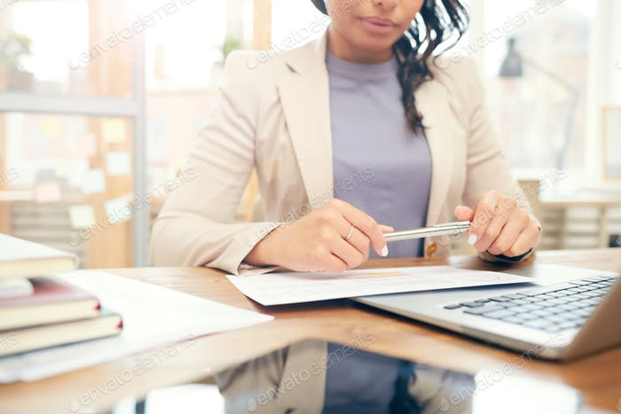 Businesswoman Reading Document at Workplace Close Up