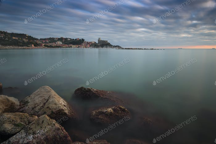 the village of Lerici photographed at sunset by the rocks with m