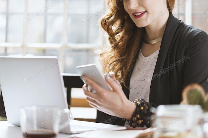 Female architect during coffee break