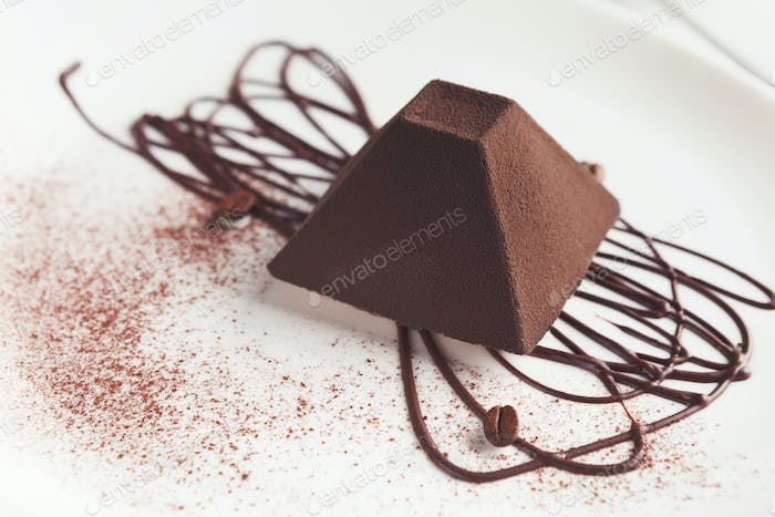 Chocolate truffle cake in pyramid shape