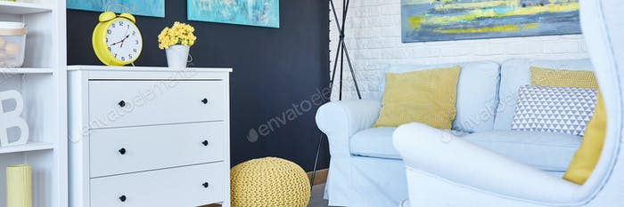 Yellow additions in white room