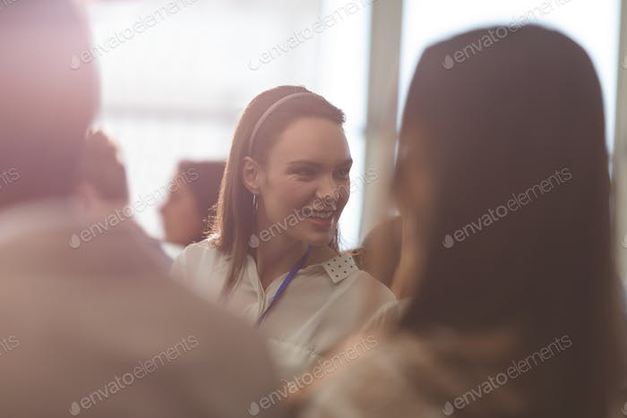 Side view of young Caucasian businesswoman attending a business seminar in office building