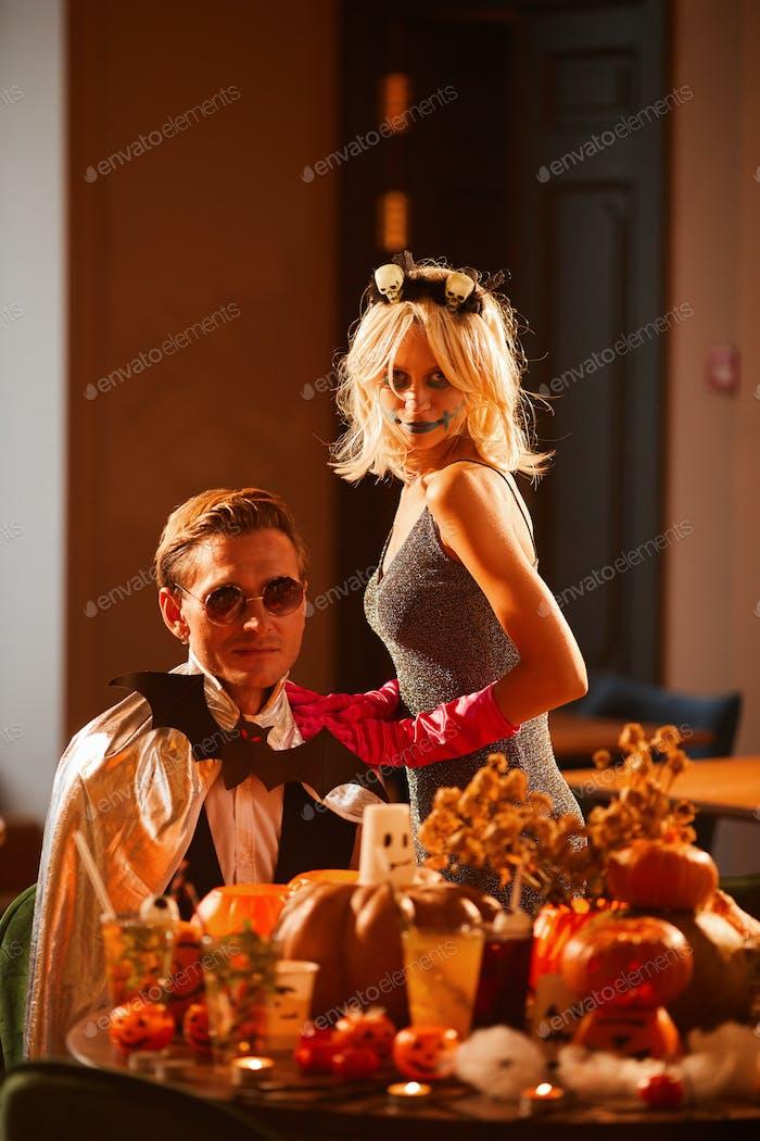 Couple Posing in Halloween Costumes