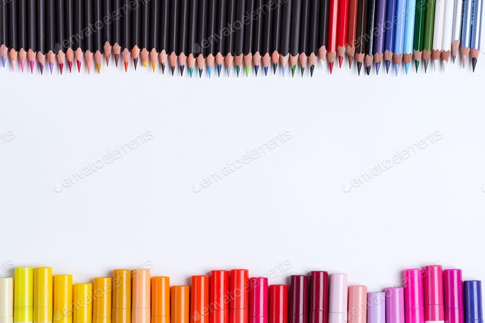 Painting multicolored border from colorful markers and pencils for art creativity on a white