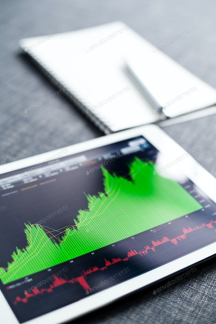 Stock market graph on tablet computer