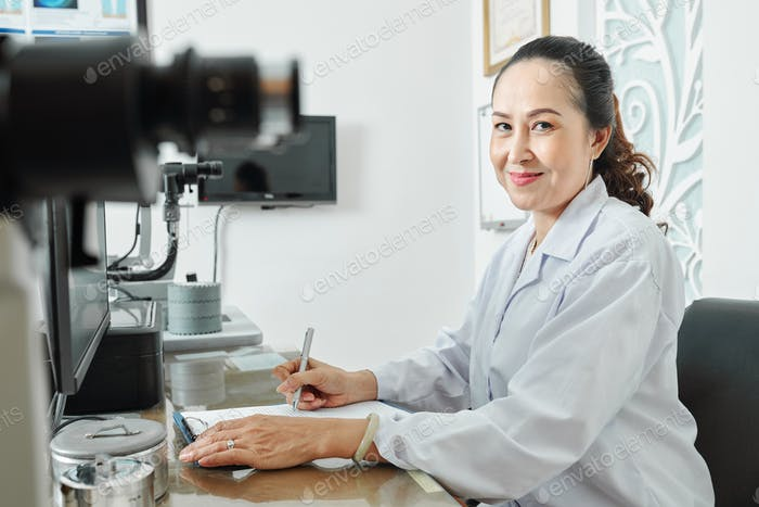 Female optometrist at office