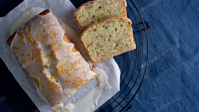 Lemon cupcake with poppy seeds. Traditional homemade cakes. Lemon bread with sugar icing