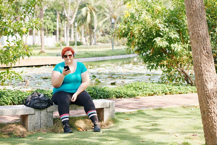 Overweight woman resting in park
