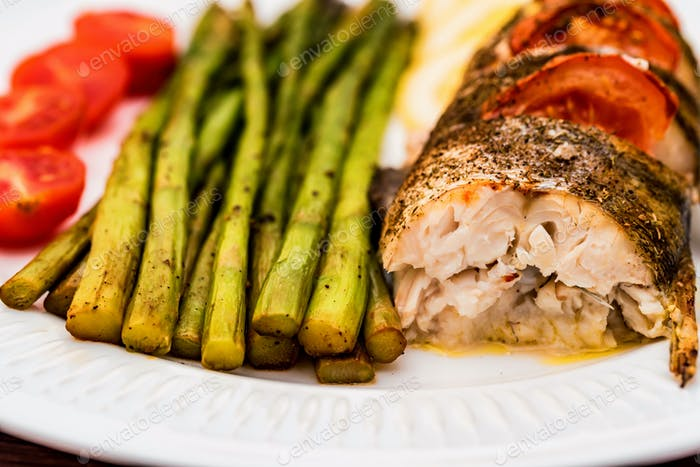Roasted zander fillet with asparagus and lemon