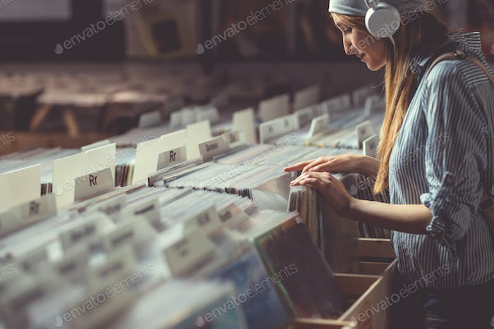 Attractive girl in a vinyl store