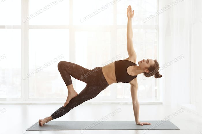 Side Plank. Woman Practicing Yoga In Studio, Vasisthasana Exercise