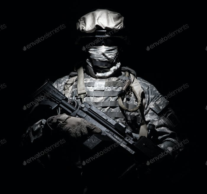 Infantry with machine gun standing in darkness