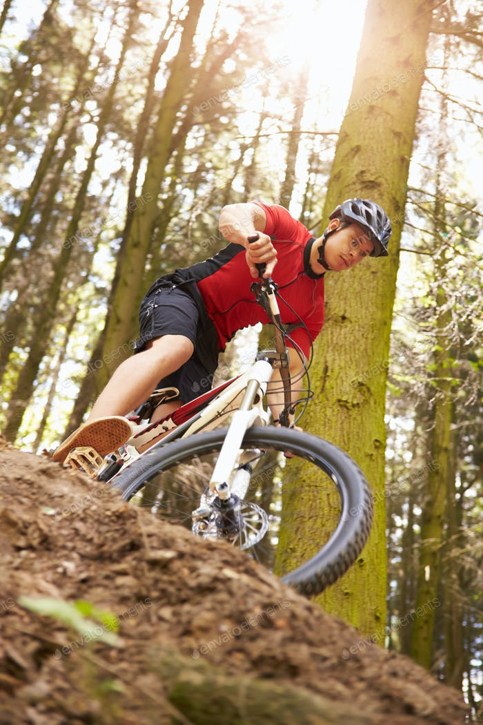 Man Riding Mountain Bike Through Woods
