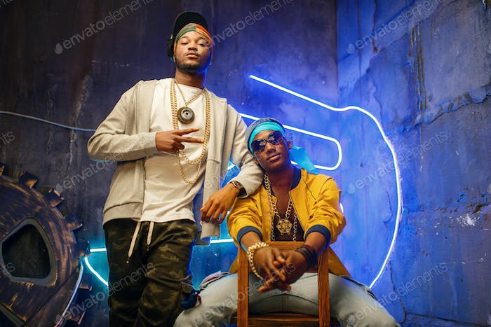 Two black rappers, neon lights on background