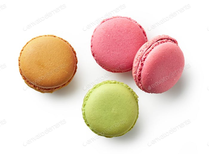 various colorful macaroons on white background