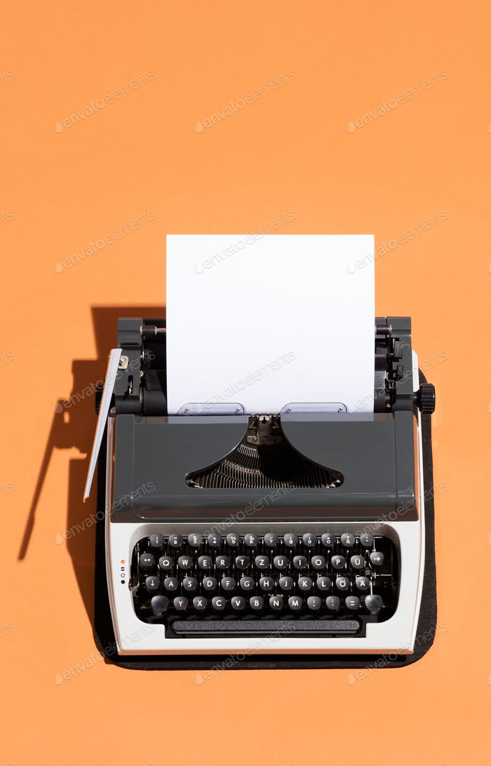 Vintage typewriter with a white blank page