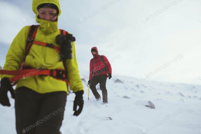 Hiker hiking on a snowy mountain