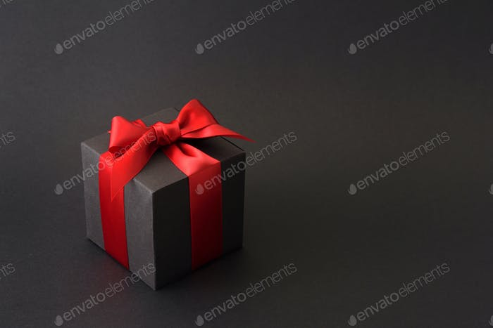 Black gift box with red bow