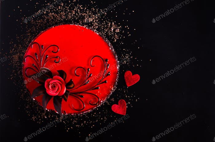 Red Cake with rose, two hearts on black background. Top view. Valentine's Day. Free space for