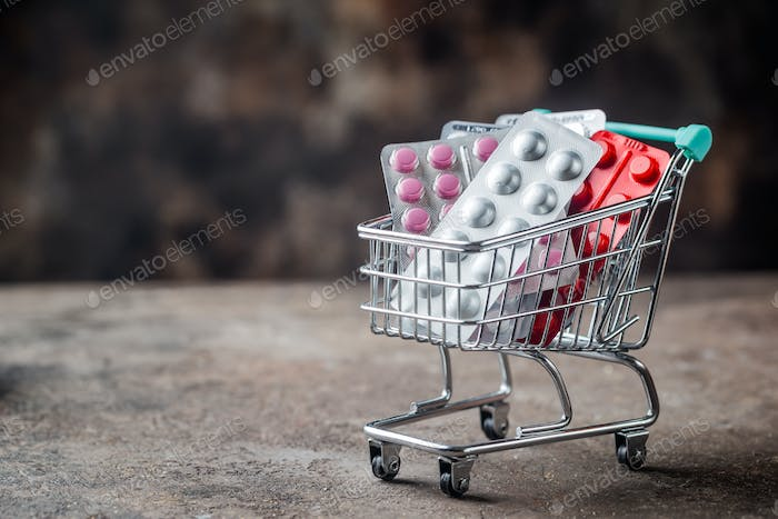 Shopping cart filled with pills.