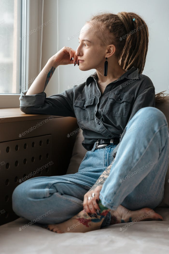 Concentrated young girl with dreadlocks