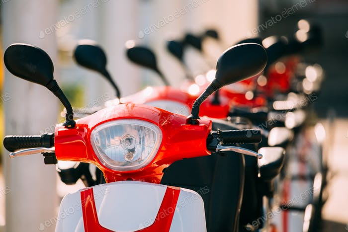 Many Electric Motorbikes, Motorcycles Scooters Parked In Row In