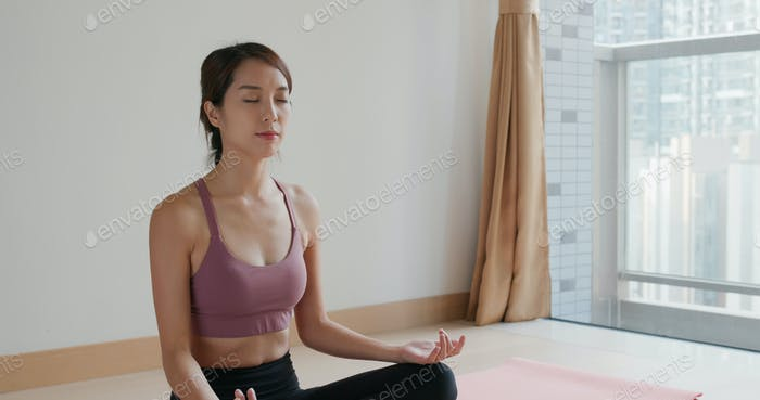 Woman do meditation yoga at home