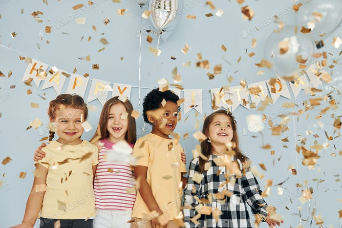 Children on celebrating birthday party indoors have fun together