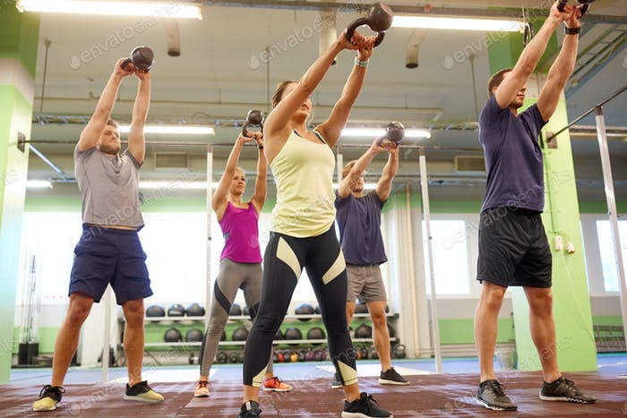Thumbnail for group of people with kettlebells exercising in gym