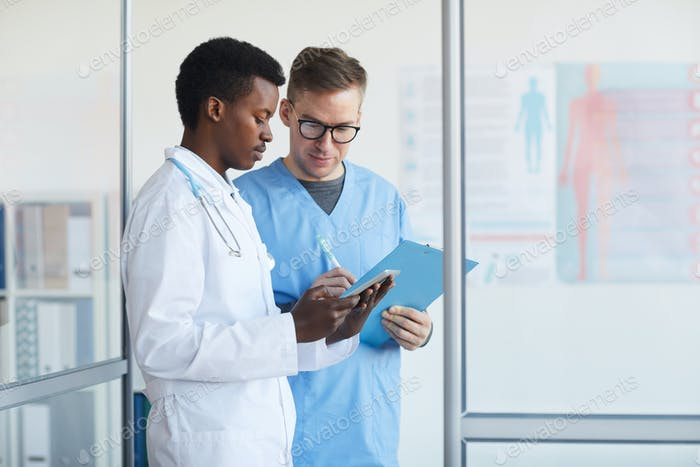 Doctors Filling Patient Reports in Clinic