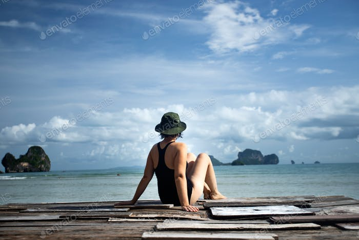 Summer vacation concept with young woman relaxing on the beach,