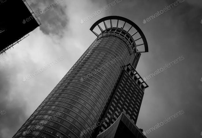 Modern architecture design of a Skyscraper building. Black and white futuristic exterior against