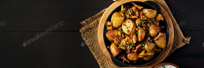Baked potatoes with garlic, herbs and fried chanterelles in a ca