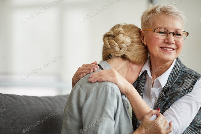 Smiling Female Psychologist Comforting Woman in Therapy Session