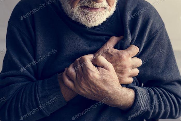 Close up of elderly man having a heart attack