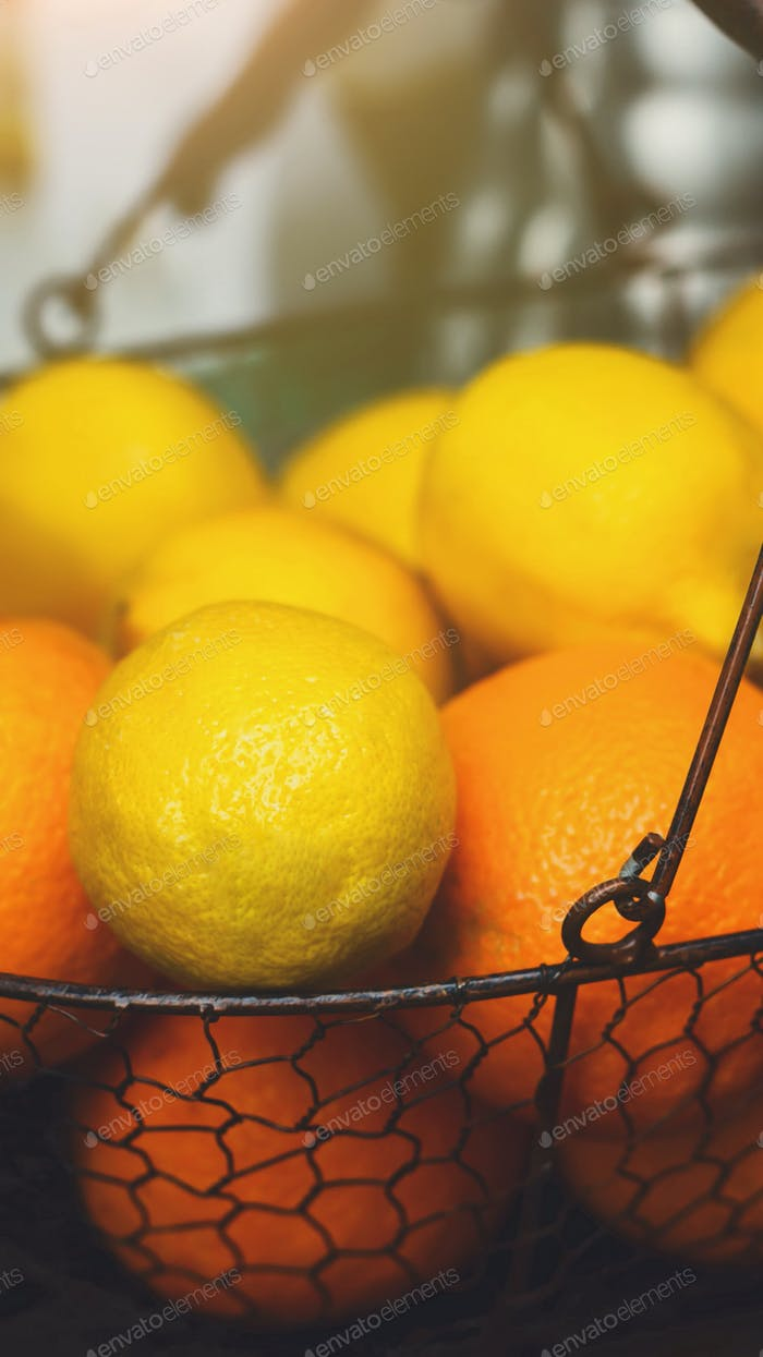 Oranges and Lemons in basket on bar counter