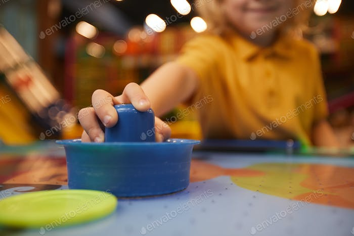 Boy playing in table hockey