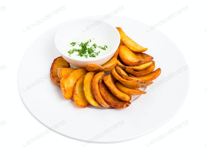 Roast potato wedges with tartar sauce.