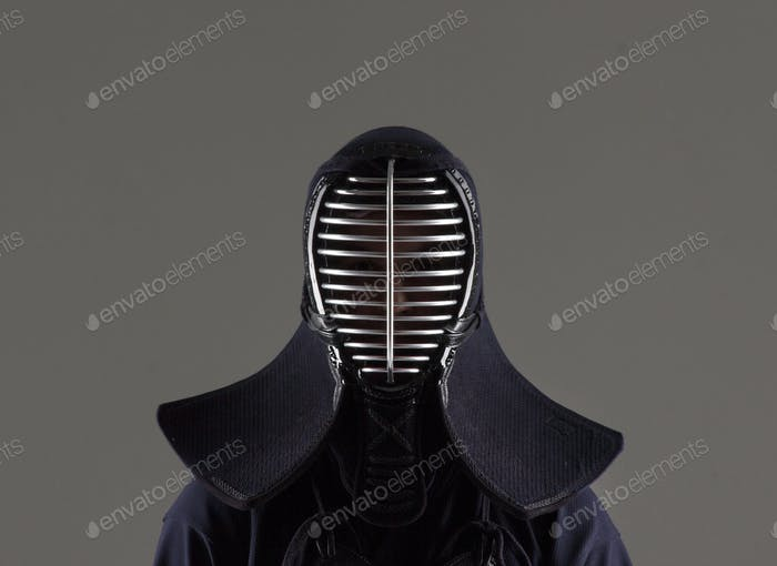 male in tradition kendo armor wearing helmet.