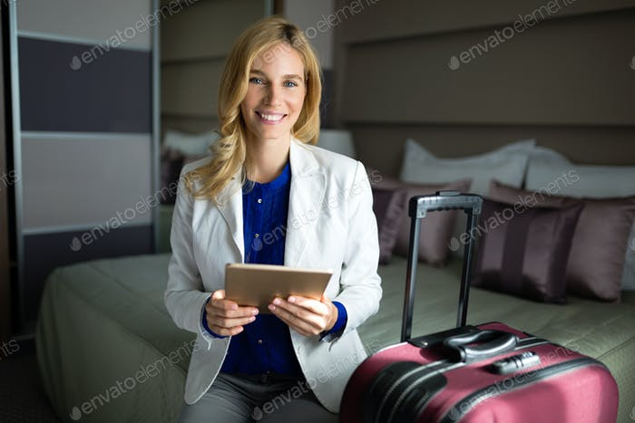 Portrait of attractive businesswoman in hotel room