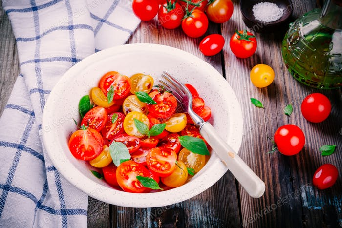 Salad of organic cherry tomatoes with basil, balsamic and olive