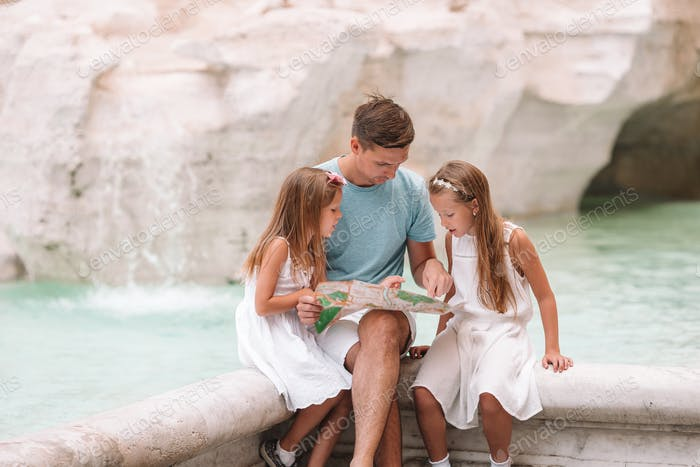 Happy kids and dad enjoy their european vacation in Italy