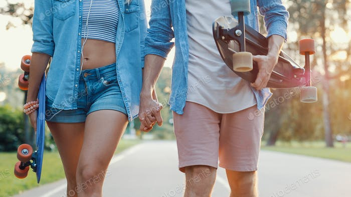 Young couple with skateboards