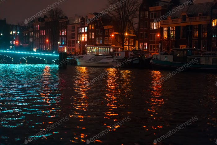 Night illumination of buildings and boats in the canal.