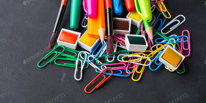 Colorful stationery back to school concept on dark