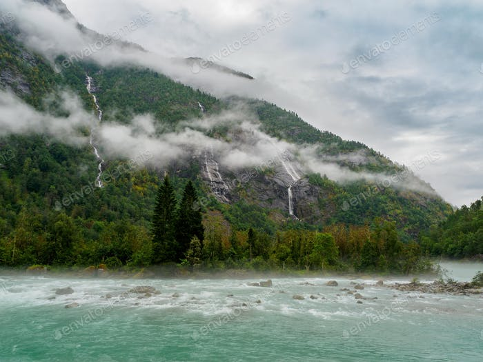 Misty scenic road to Nigardsbreen glacier, Norway.