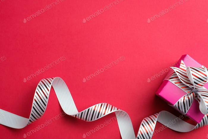 Red gift box with stripe ribbon